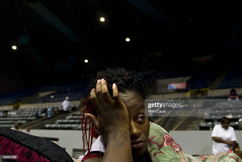 Domineak Wilson (20) and 14 other family members take shelter at the Jackson Convention Center where victims took refuge from Hurricane Katrina on September 2, 2005 in Jackson, Mississippi. Shelters throughout Mississippi are accomodating refugees from states including Louisiana.