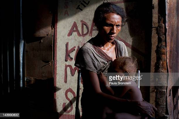 Domingas holds her son Tinan 18 months outside their small shack April 21 2012 in Dili East Timor Millions have been spent on aid during the first 10...