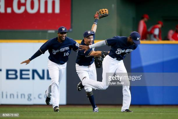 Domingo Santana Hernan Perez and Lewis Brinson of the Milwaukee Brewers celebrate after beating the St Louis Cardinals 21 at Miller Park on August 3...
