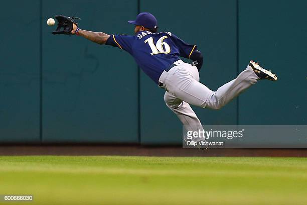 Domingo Santana of the Milwaukee Brewers attempts to catch a line drive against the St Louis Cardinals in the first inning at Busch Stadium on...