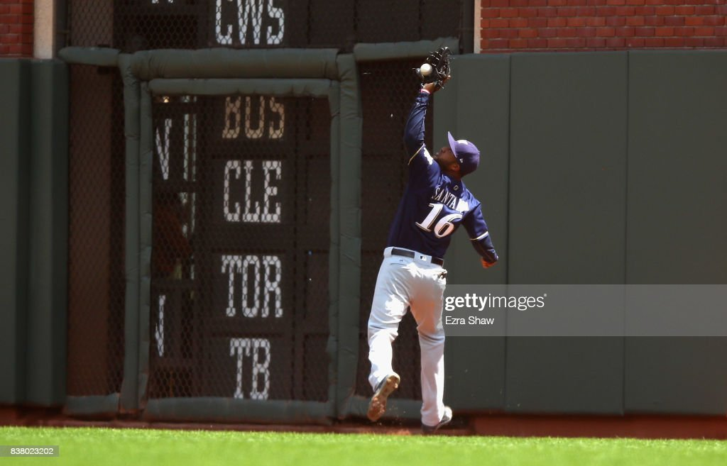 Domingo Santana #16 of the Milwaukee Brewers catches a ball hit by Buster Posey #28 of the San Francisco Giants in the third inning at AT&T Park on August 23, 2017 in San Francisco, California.