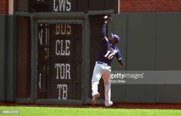 Domingo Santana of the Milwaukee Brewers catches a ball hit by Buster Posey of the San Francisco Giants in the third inning at ATT Park on August 23...