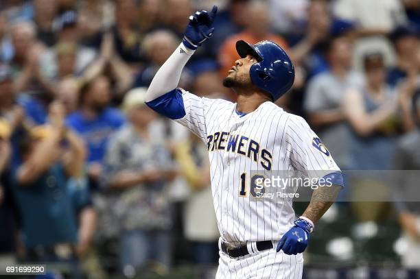 Domingo Santana of the Milwaukee Brewers celebrates a home run during the seventh inning of a game against the Los Angeles Dodgers at Miller Park on...
