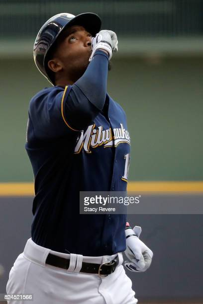 Domingo Santana of the Milwaukee Brewers celebrates a home run during the sixth inning of a game against the Chicago Cubs at Miller Park on July 30...