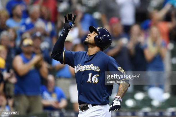 Domingo Santana of the Milwaukee Brewers celebrates a three run home run during the first inning against the Cincinnati Reds at Miller Park on...