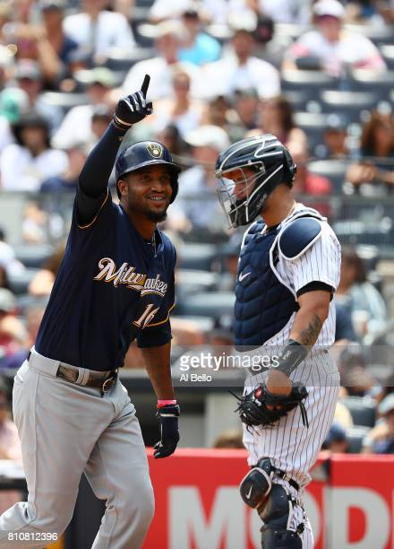 Domingo Santana of the Milwaukee Brewers celebrates after hitting a three run home run against the New York Yankees in the first inning during their...
