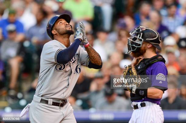 Domingo Santana of the Milwaukee Brewers celebrates after hitting a second inning solo homerun hit against the Colorado Rockies at Coors Field on...