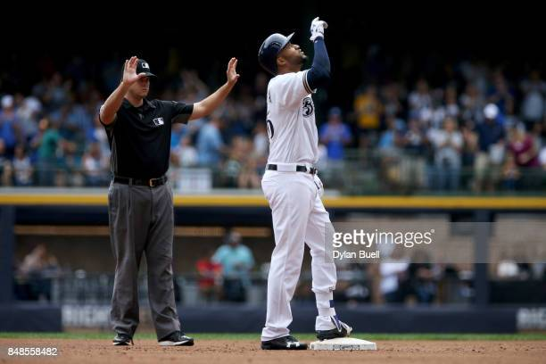 Domingo Santana of the Milwaukee Brewers celebrates after hitting a double in the fourth inning against the Miami Marlins at Miller Park on September...