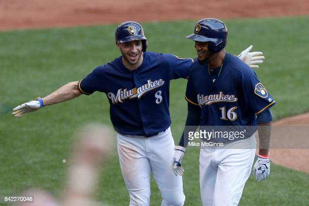 Domingo Santana of the Milwaukee Brewers celebrates with Ryan Braun after hitting a two run homer in the fourth inning against the Washington...