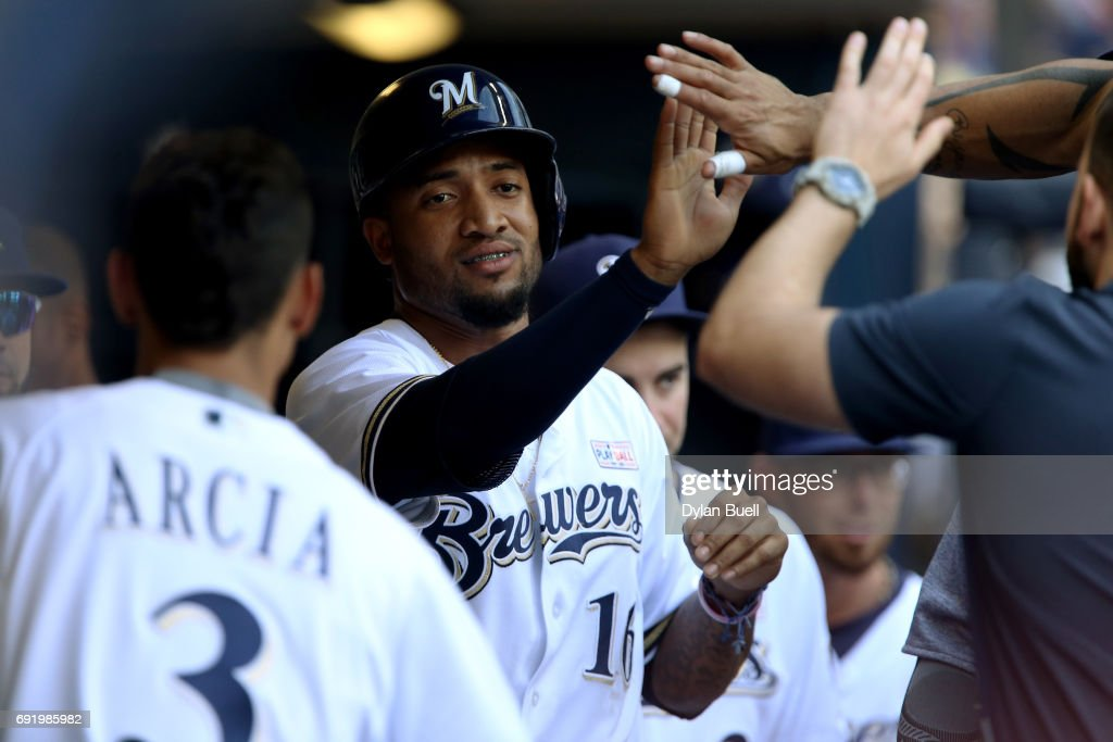 Domingo Santana #16 of the Milwaukee Brewers celebrates with teammates after scoring a run in the first inning against the Los Angeles Dodgers at Miller Park on June 3, 2017 in Milwaukee, Wisconsin.