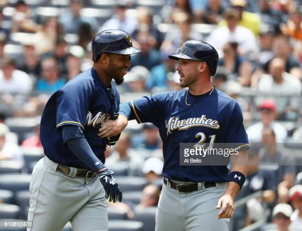 Domingo Santana of the Milwaukee Brewers celebrates with Travis Shaw after hitting a three run home run against the New York Yankees in the first...