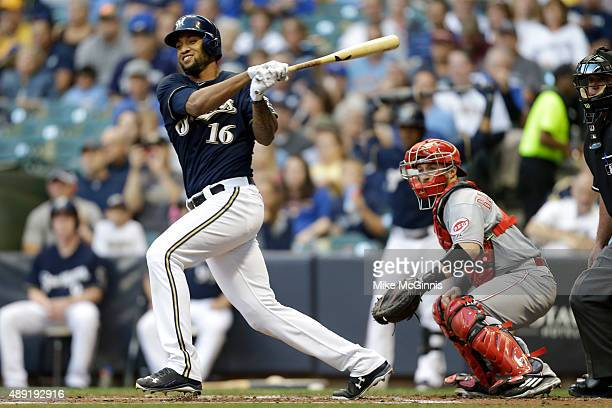Domingo Santana of the Milwaukee Brewers hits a 2 RBI double in the first inning against the Cincinnati Reds at Miller Park on September 19 2015 in...