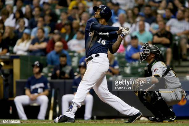 Domingo Santana of the Milwaukee Brewers hits a home run in the seventh inning against the Pittsburgh Pirates at Miller Park on June 21 2017 in...