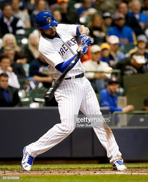 Domingo Santana of the Milwaukee Brewers hits a single against the San Diego Padres at Miller Park on May 13 2016 in Milwaukee Wisconsin