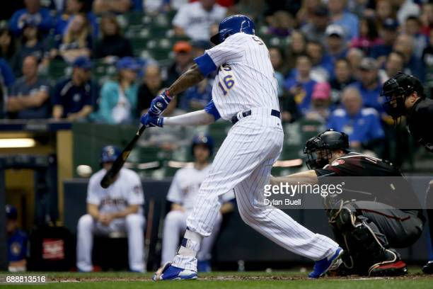 Domingo Santana of the Milwaukee Brewers hits a single in the second inning against the Arizona Diamondbacks at Miller Park on May 26 2017 in...