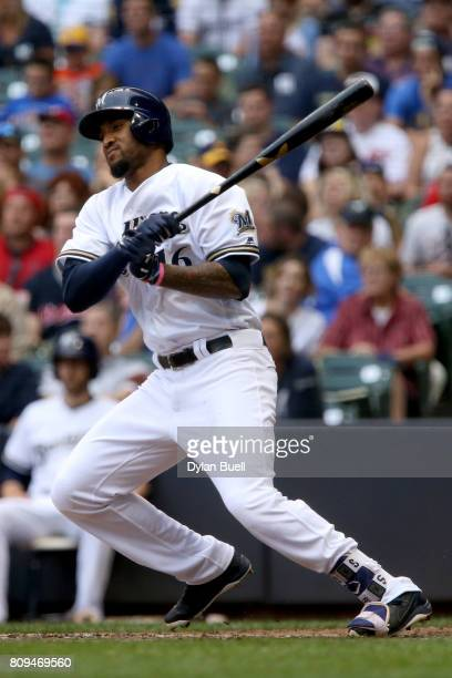 Domingo Santana of the Milwaukee Brewers hits a single in the third inning against the Baltimore Orioles at Miller Park on July 5 2017 in Milwaukee...