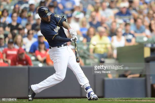 Domingo Santana of the Milwaukee Brewers hits a three run home run against the Cincinnati Reds during the fifth inning at Miller Park on August 13...