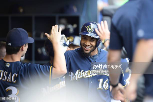 Domingo Santana of the Milwaukee Brewers is congratulated by teammates following a three run home run against the Cincinnati Reds during the fifth...