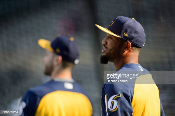 Domingo Santana of the Milwaukee Brewers looks on during batting practice before the game against the Minnesota Twins on August 7 2017 at Target...