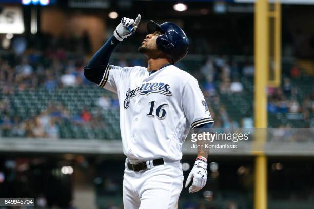 Domingo Santana of the Milwaukee Brewers looks up after hitting a single during the ninth inning against the Miami Marlins at Miller Park on...