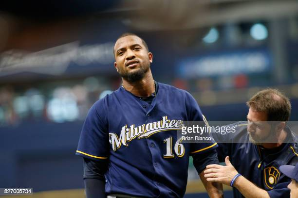 Domingo Santana of the Milwaukee Brewers reacts as he's evaluated by a team trainer after being hit by a pitch by Chris Archer of the Tampa Bay Rays...