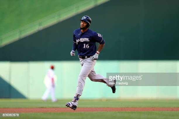 Domingo Santana of the Milwaukee Brewers rounds the bases after hitting a home run in the first inning during the game against the Washington...
