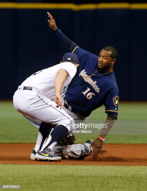 Domingo Santana of the Milwaukee Brewers steals second base ahead of second baseman Brad Miller of the Tampa Bay Rays during the eighth inning of a...