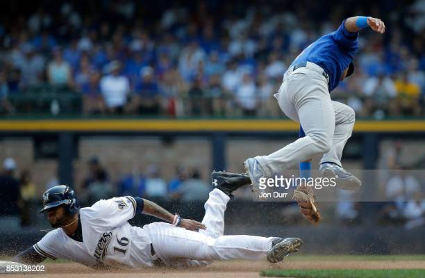 Domingo Santana of the Milwaukee Brewers steals second base as Addison Russell of the Chicago Cubs is late on the tag during the sixth inning at...