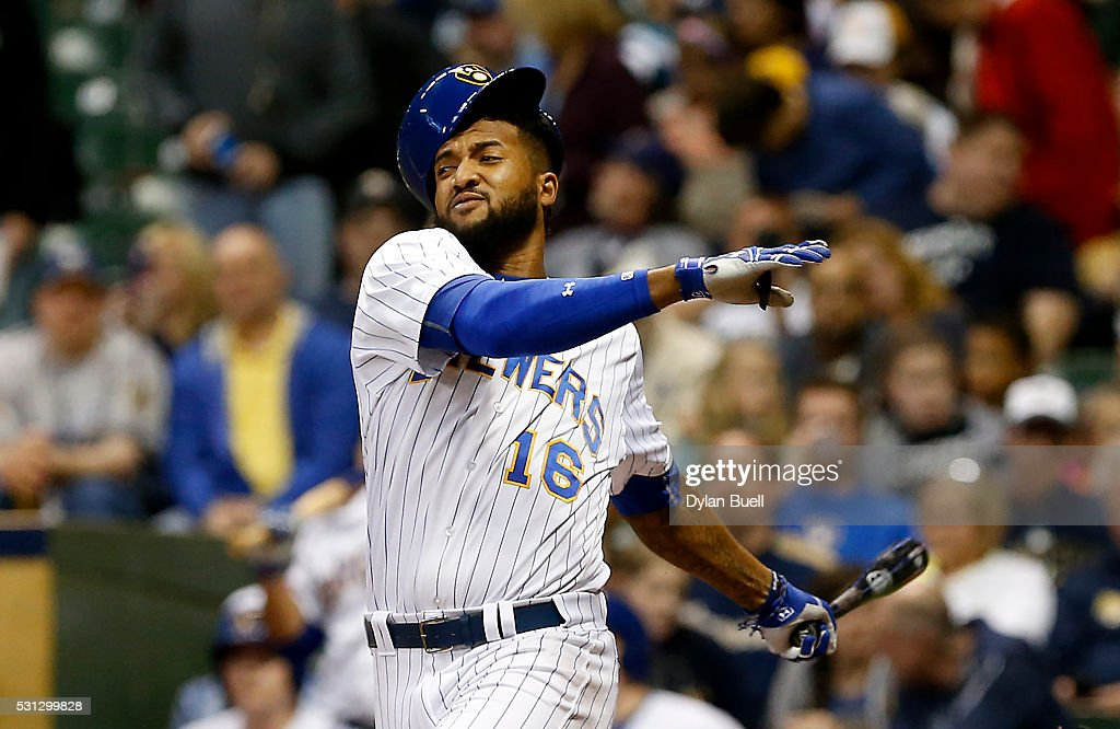 Domingo Santana of the Milwaukee Brewers swings and misses a pitch in the fifth inning against the San Diego Padres at Miller Park on May 13 2016 in...