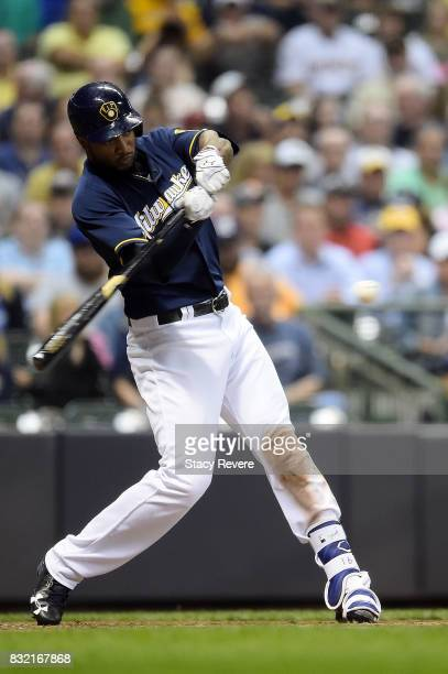 Domingo Santana of the Milwaukee Brewers swings at a pitch during the sixth inning of a game against the Pittsburgh Pirates at Miller Park on August...