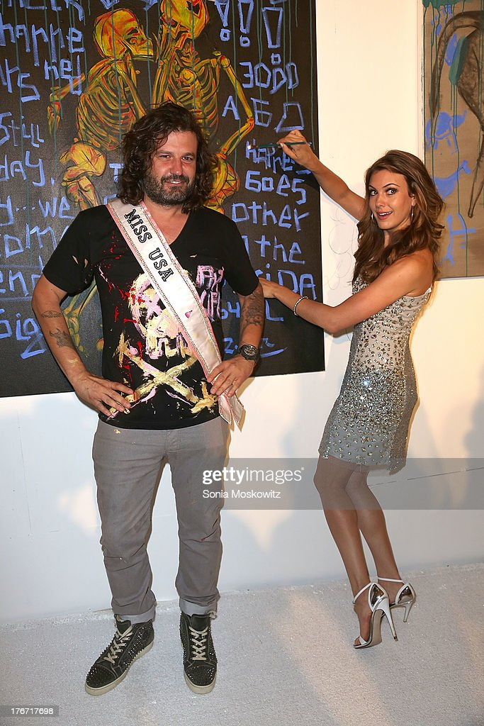 Domingo Zapata and Miss USA Erin Brady attend Domingo Zapata's A Contemporary Salon event on August 17, 2013 in Watermill, New York.