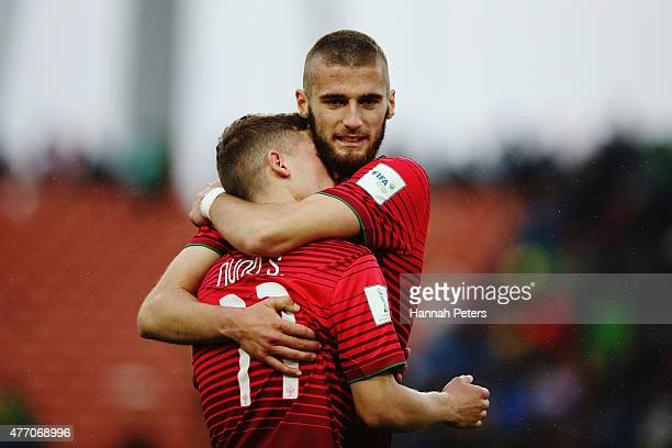 Domingos Duarte of Portugal consoles Nuno Santos of Portugal after losoing the FIFA U20 World Cup New Zealand 2015 quarter final match between Brazil...