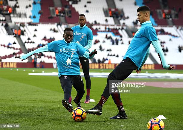 Domingos Quina of West Ham United and Ashley Fletcher of West Ham United warm up prior to the Premier League match between West Ham United and...