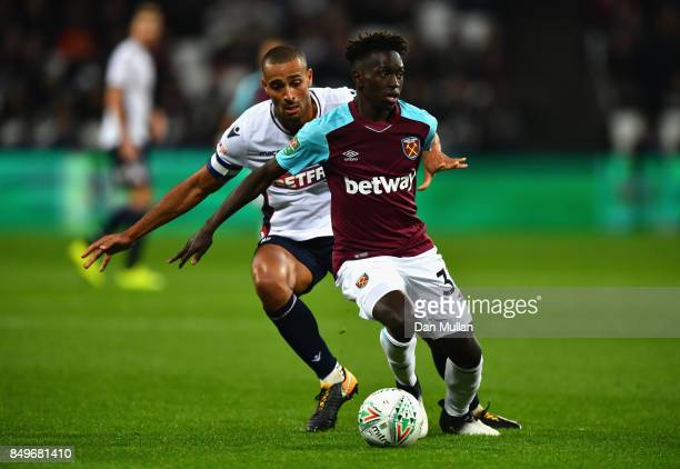 Domingos Quina of West Ham United and Darren Pratley of Bolton Wanderers battle for possession during the Carabao Cup Third Round match between West...