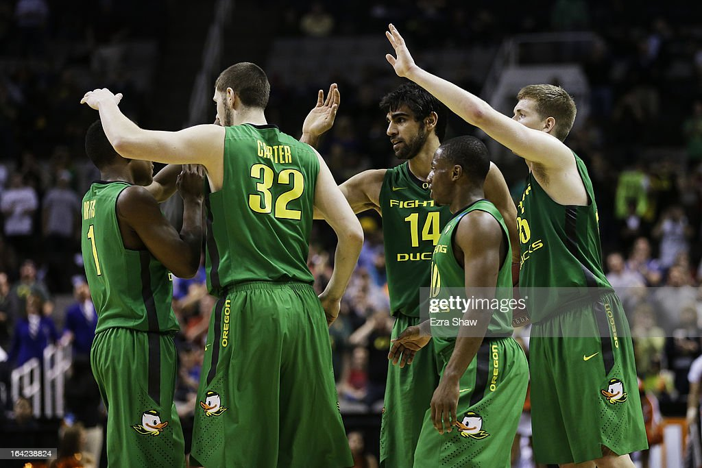 Dominic Artis #1, Ben Carter #32, Arsalan Kazemi #14, Johnathan Loyd #10 and E.J. Singler #25 of the Oregon Ducks celebrate their 68 to 55 win over the Oklahoma State Cowboys during the second round of the 2013 NCAA Men's Basketball Tournament at HP Pavilion on March 21, 2013 in San Jose, California.