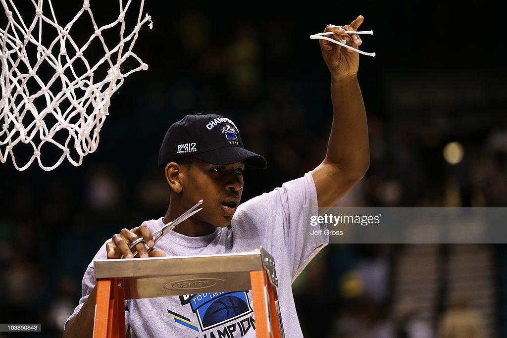 Dominic Artis #1 of the Oregon Ducks celebrates by cutting down the net after they defeated the UCLA Bruins 78 to 69 in the Pac-12 Championship game at MGM Grand Garden Arena on March 16, 2013 in Las Vegas, Nevada.