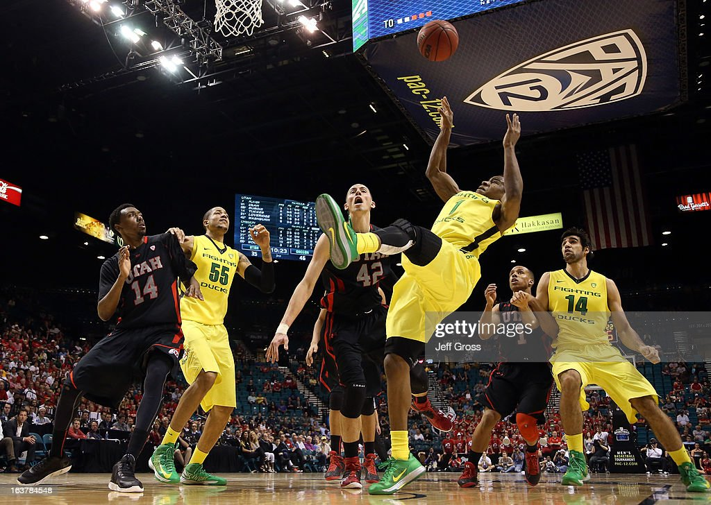 Dominic Artis #1 of the Oregon Ducks goes up for a shot over Jason Washburn #42 of the Utah Utes in the second half during the semifinals of the Pac-12 tournament at the MGM Grand Garden Arena on March 14, 2013 in Las Vegas, Nevada.