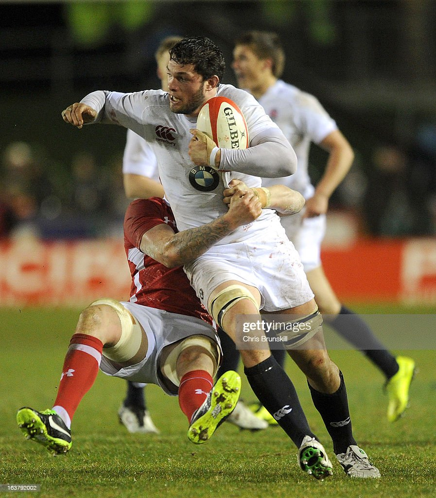 Dominic Barrow of England U20 is tackled by Carwyn Jones of Wales U20 during the match between Wales U20 and England U20 at Eirias Park on March 15, 2013 in Colwyn Bay, Wales.