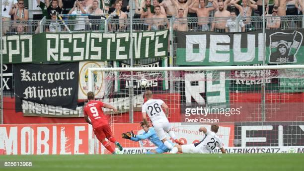 Dominic Baumann of Wuerzburg challenges goalkeeper NilJonathan Koerber Sebastian Mai Lion Schweers of Muenster during the 3 Liga match between FC...