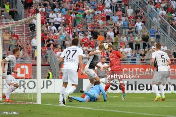 Dominic Baumann of Wuerzburg challenges Moritz Heinrich goalkeeper NilJonathan Koerber and Sebastian Mai of Muenster during the 3 Liga match between...