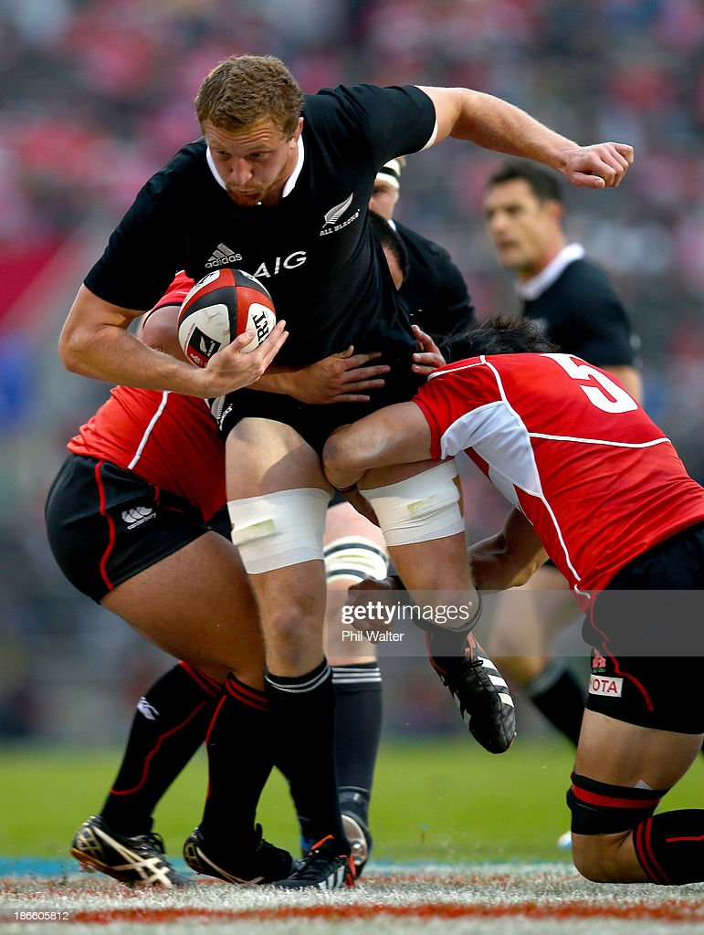 Dominic Bird of the All Blacks is tackled by <a gi-track='captionPersonalityLinkClicked' href=/galleries/search?phrase=Hitoshi+Ono&family=editorial&specificpeople=4036660 ng-click='$event.stopPropagation()'>Hitoshi Ono</a> of Japan during the International Rugby Test Match between Japan and the New Zealand All Blacks at Prince Chichibu Memorial Rugby Stadium on November 2, 2013 in Tokyo, Japan.