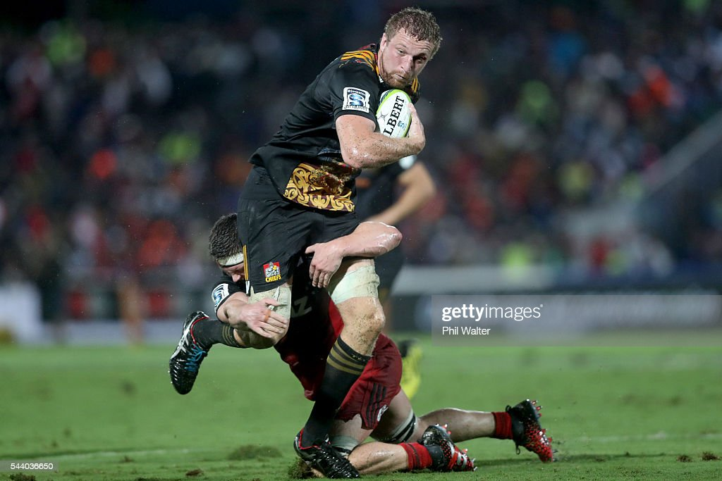 Dominic Bird of the Chiefs is tackled during the round 15 Super Rugby match between the Chiefs and the Crusaders at ANZ Stadium on July 1, 2016 in Suva, Fiji.
