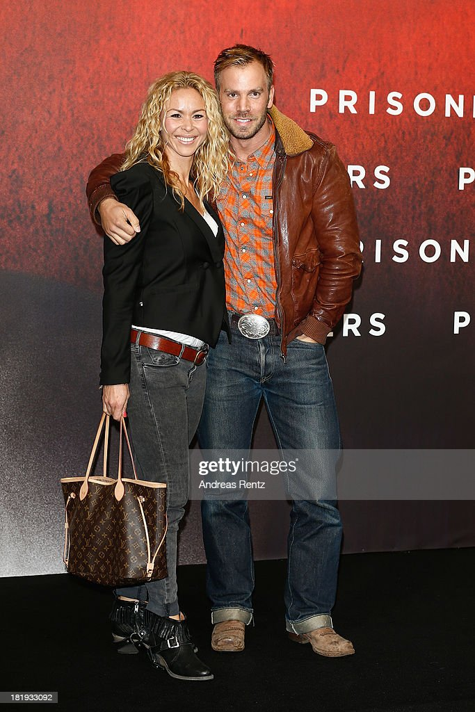 Dominic Boeer and partner attend the 'Prisoners' Germany Premiere at Sony Centre on September 26, 2013 in Berlin, Germany.