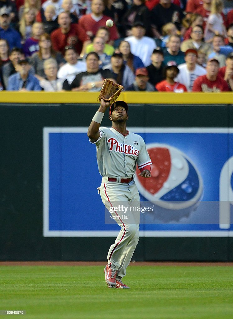 Dominic Brown #9 of the Philadelphia Phillies catches a fly ball against the Arizona Diamondbacks in the sixth inning at Chase Field on April 26, 2014 in Phoenix, Arizona.