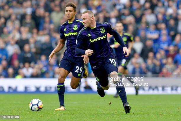Dominic CalvertLewin and Wayne Rooney of Everton during the Premier League match between Brighton and Hove Albion and Everton at Amex Stadium on...