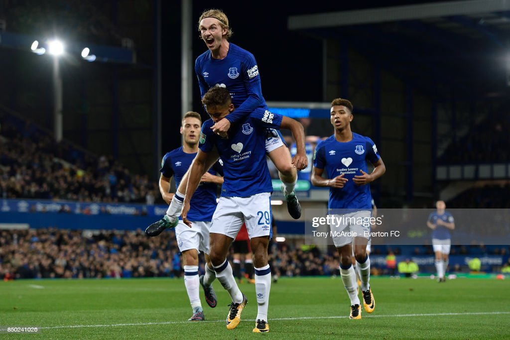 Dominic Calvert-Lewin celebrates his goa with Tom Davies (top) during the Carabao Cup Third Round match between Everton and Sunderland at Goodison Park on September 20, 2017 in Liverpool, England.
