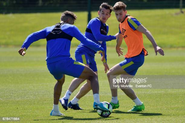 Dominic CalvertLewin Leighton Baines and Joe Williams challenge for the ball during the Everton FC training session at USM Finch Farm on May 4 2017...