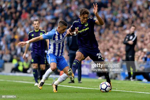 Dominic CalvertLewin of Everton and Anthony Knockaert challenge for the ball during the Premier League match between Brighton and Hove Albion and...