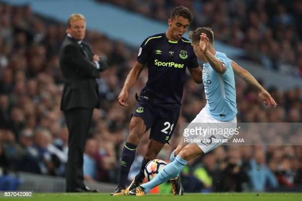 Dominic CalvertLewin of Everton and John Stones of Manchester City during the Premier League match between Manchester City and Everton at Etihad...
