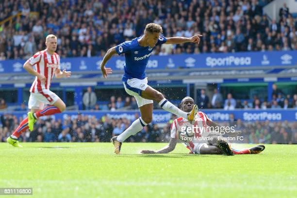 Dominic CalvertLewin of Everton and Kurt Zouma of Stoke City challenge for the ball during the Premier League match between Everton and Stoke City at...